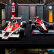 Постер, плакат: Formula One racing cars McLaren M26 1976 and Marussia MR02 2013