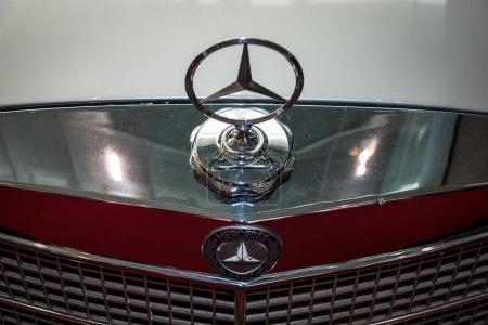 Hood ornament of Mercedes-Benz (three-beam star), closeup.