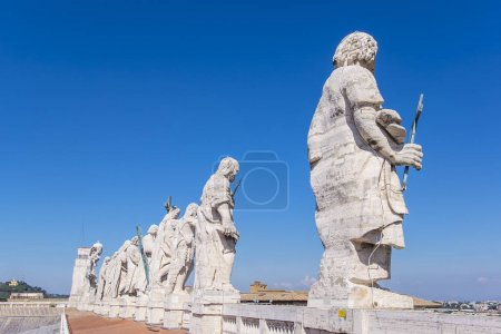 Statues of Saints of St. Peter's Basilica in Rome Against Blue Sky