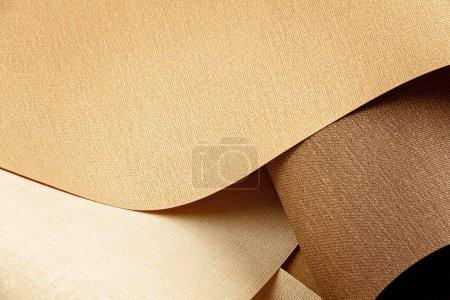 Foto de Abstract backgroud of rolled textured paper sheets of different shades. Cierre de las formas abstractas geométricas - Imagen libre de derechos