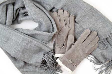 Photo for Flat lay composition with grey winter gloves and a warm woolen scarf. Comfort clothers for the cold winter weather - Royalty Free Image