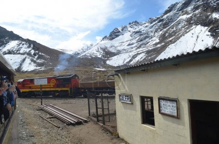 Tourists take photos from the Ferrocarril Central Andino train as it passes through Galera station on the Lima - Huancayo line