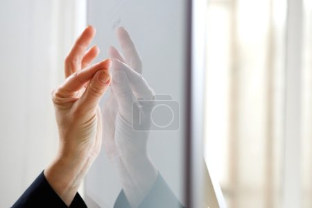Fingers pinching icon on screen