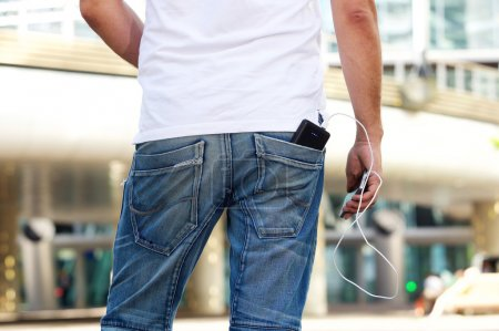 Mobile phone with battery pack in back pocket
