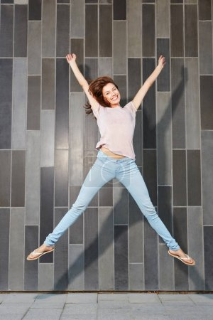 Attractive woman jumping in air