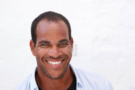 Close up portrait of handsome man laughing standing isolated on white