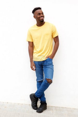 Photo for Full body portrait of young black man smiling abasing white background - Royalty Free Image