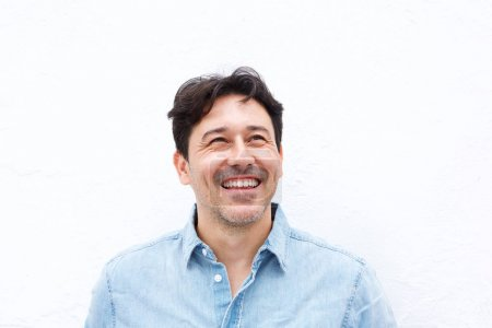 Close up portrait of happy older man looking away and smiling isolated on white background