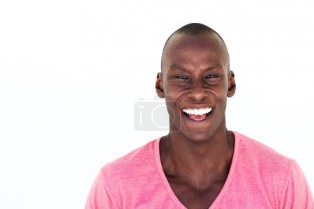 Portrait of happy african american man laughing against isolated white background