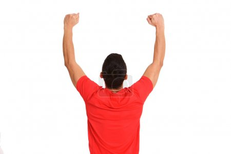 Portrait from behind of a happy mature male runner standing with arms raised and clenched fist on white background