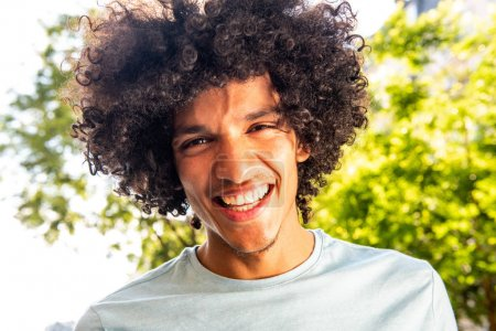 Photo for Close up portrait young North African man with afro hair laughing outside - Royalty Free Image