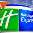 Постер, плакат: Holiday Inn Express and Suites Sign and Logo