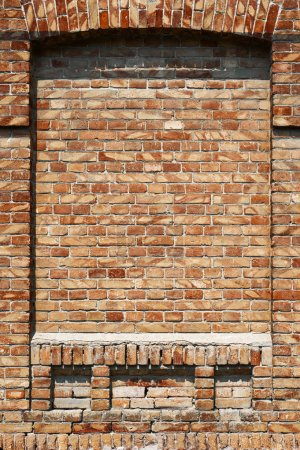 Old brick wall for texture or background, red and brown color, architectural elements as a brick filled window