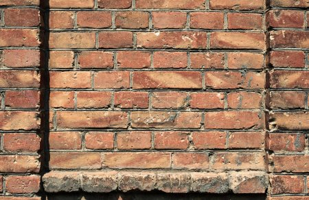 Old brick wall for texture or background, red and brown color, architectural elements as a brick filled frame
