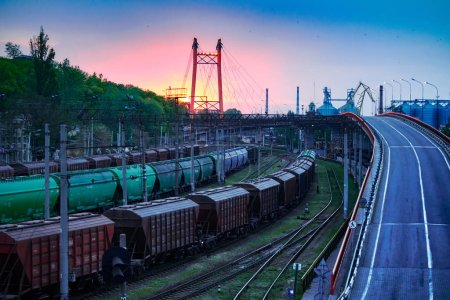 railroad transportation, freight cars in industrial seaport at sunset