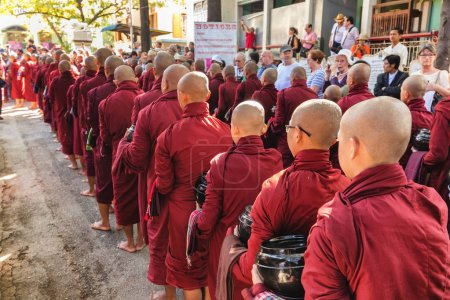 Burmese monks queueing for meal