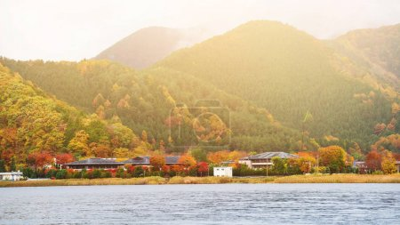Kawaguchiko lake with fall colors at sunrise