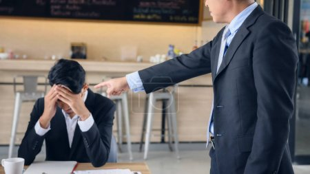 Angry boss  complain young businessman