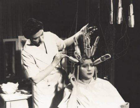 Hairdresser using perm machine