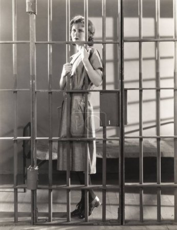 Woman standing in prison