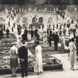 People at party in formal garden...