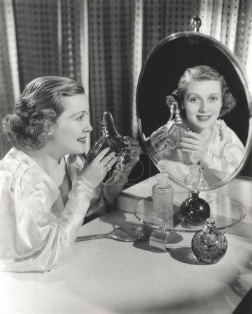 woman holding perfume bottle
