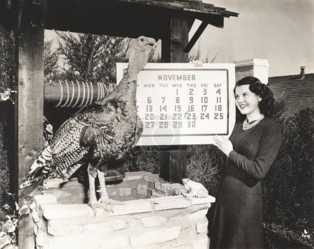 Woman holding calendar while looking at turkey