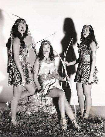 Women wearing archer costumes