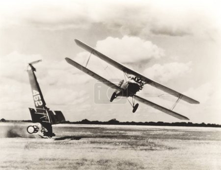 Biplane flying by crashed air vehicle