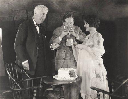Photo for Three people enjoying a slice of cake - Royalty Free Image