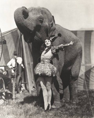 performer posing with elephant