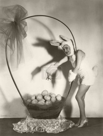 Woman with basket of Easter eggs