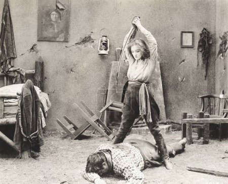 woman attacking man with sword