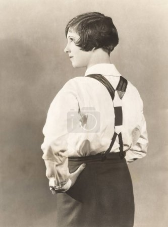 Woman standing with hand on hip