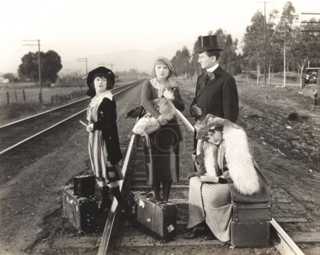Women and man on railway tracks