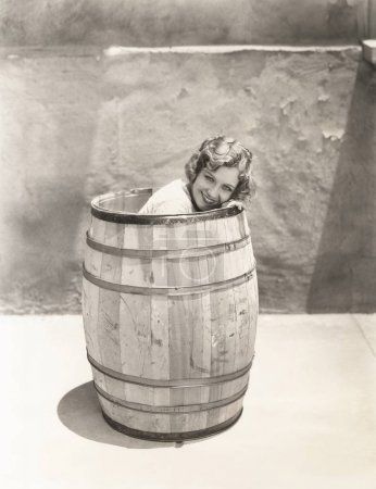 woman sitting inside barrel