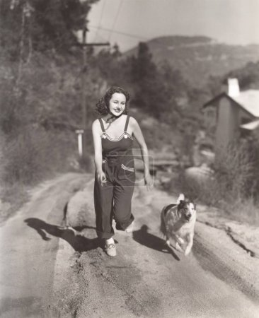 woman and dog running on street