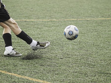 Man playing soccer