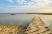Wooden pier at Neusiedlersee lake in spring, Burgenland, Austria