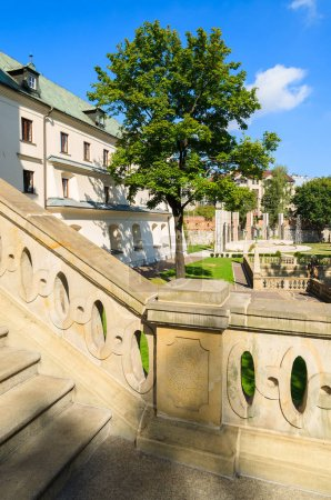Stone stairs in public park area of a church (Na Skalce) in Krakow, Poland