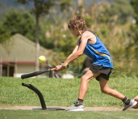 young preteen boy playing softball