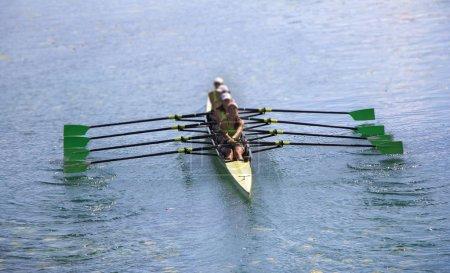 Team of rowing Four-oar women in boat