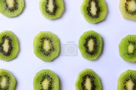 Photo for Juicy kiwi slices on white background with place for text. vitamins, diet, proper nutrition. flatlay - Royalty Free Image
