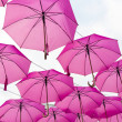 Hanging pink umbrellas on the occasion of Breast C...