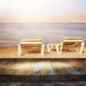 Empty old table in front of tropical sea and beach. Useful for product display montage