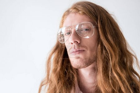 Photo for Portrait of handsome man with curly ginger hair and glasses looking at camera isolated on white - Royalty Free Image