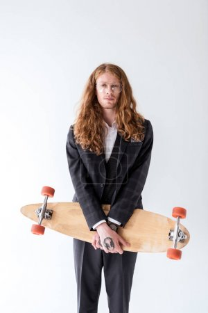 Photo for Stylish businessman with curly hair holding longboard isolated on white - Royalty Free Image
