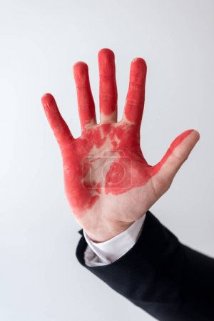 cropped image of businessman showing hand in blood isolated on white