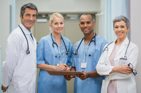 Photo for Portrait of cheerful doctors team looking at camera. Smiling team of senior doctors and young nurses at hospital. Portrait of confident happy multiethnic group of doctors at medical clinic. - Royalty Free Image