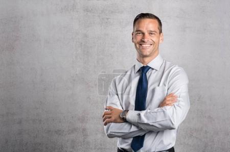 Proud businessman smiling
